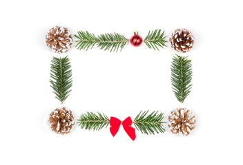 Christmas frame of pine cones and fir branches on a white wooden background. Flat lay, top view, copy space