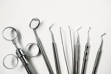 dental and endodontic restoration instruments on a white background. Top view