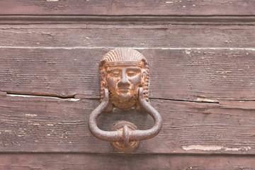 Specchia, Apulia - A very old pharaoh door knob on a wooden door