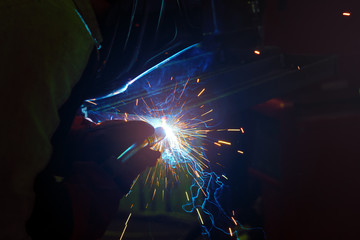 sparks during welding at the production process in semi-automatic welding of metal in argon protective gases