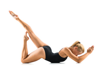 Foto auf Leinwand Gymnastik Young blonde woman in maillot practicing yoga lesson