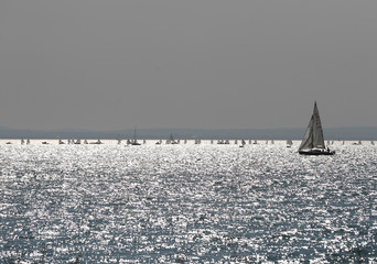 Sailboats are seen in Lake Balaton on a sunny autumn day near Balatonkenese