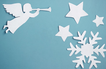 Christmas background or greeting card with angel and snowflake.