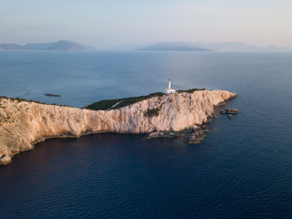 Lighthouse high above the sea at golden hour, in Lefkada, Greece