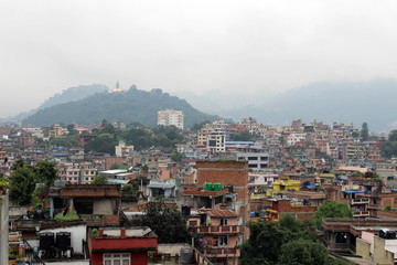 The view of Swayambhunath Stupa from the rooftop in Kathmandu during cloudy day
