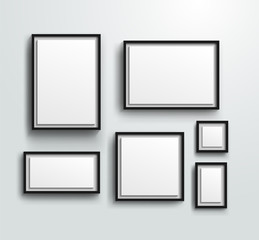 Blank photo frames on the wall. Design for a modern interior. Vertical and horizontal A-4, and square picture frame. Vector illustration. Isolated on white background.