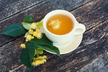 linden flowers herbal  Cup of healthy tea with honey. alternative or complementary medicine, traditional medicine. soft focus image