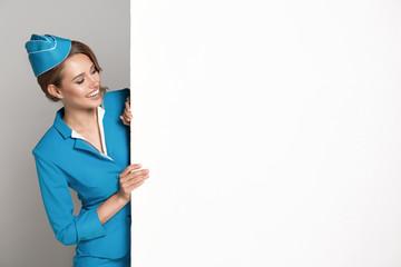 Portrait of charming stewardess wearing in blue uniform. Empty blank copyspace.