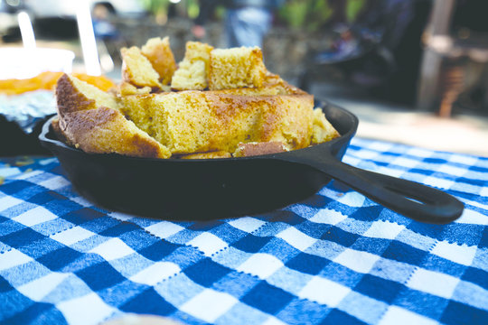 Cornbread in Cast Iron Skillet Frying Pan Blue White Checkered Table Cloth