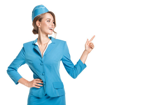 Portrait of charming stewardess wearing in blue uniform. Isolated on white background.