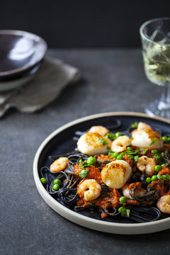 Squid ink pasta with prawns and scallops