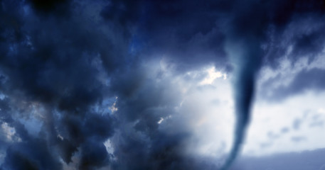 Conceptual image of cloudscape image of storm with dark clouds and approaching tornado