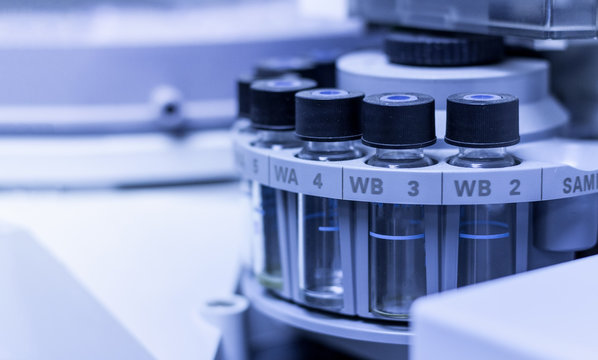 Quality Control Laboratory medicine by equipment. Vials on autosampler of gas chromatography-mass spectrophotometer.