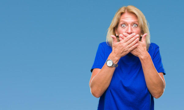 Middle age blonde woman over isolated background shocked covering mouth with hands for mistake. Secret concept.