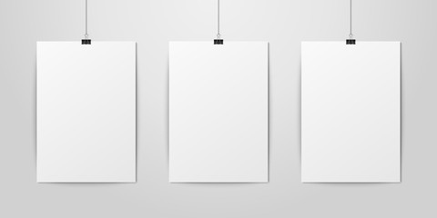 Three Vector Realistic White Blank Vertical A4 Paper Poster Hanging on a Rope with Binder Clip Set on White Wall mock-up. Empty Poster Design Template for Graphics, Mockup