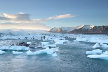 Icelandic glacier Jokulsarlon with icebergs floating in the sea