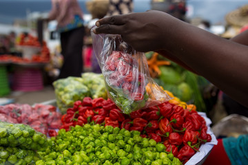 Buying peppers in the market