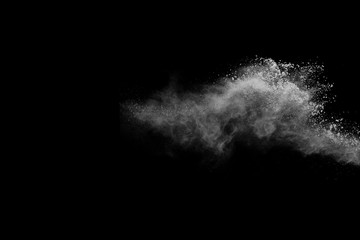White powder isolated on black background.
