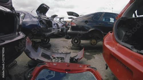 Many Cars Inside A Junkyard Being Salvage For Car Parts Vehicle