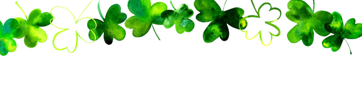 A banner with hand drawn watercolor shamrocks, Irish clovers, on a white background with copy space