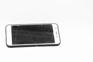 broken mobile phone on white background