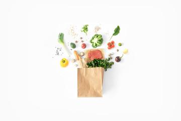 Obraz Full paper bag healthy food white background Healthy eating background - fototapety do salonu