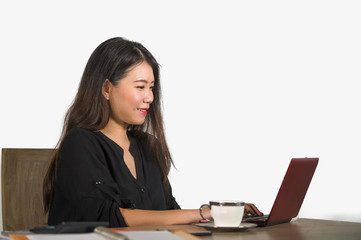 beautiful and happy Asian Chinese business woman working relaxed at corporate company computer desk smiling cheerful  as successful investor or CEO in job lifestyle