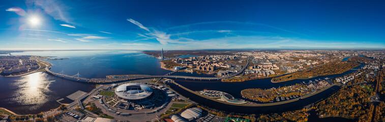 Skyscraper Gulf Finland. Autumn Park area. Residential complex. Stadium Zenit Arena. Top view air drone.