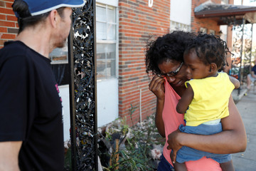 Shauntese Russell, 23, cries while talking with one of her neighbors in the aftermath of Hurricane Michael in Lynn Haven