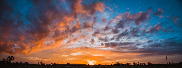 Wall Mural - landscape panorama sunset evening twilight in rural, dramatic sky with clouds