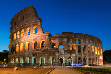 Poster de jardin Rome Colosseum in Rome, illumination at night with blue sky, Rome, Italy,