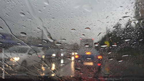 Traffic in Rain in City, Driving Car, Heavy Storm on Road, Highway