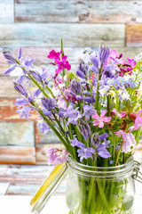 Colorful bouquet with spring wild  hyacints and another meadow flowers