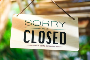 Sorry we are closed sign hang on door of business shop. Wall mural