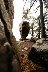 Scenic View of Rock Formation with Trees and Rocks Overlooking Cliff of a Dense Forest with Foggy atmosphere in Autumn. Balanced Rock Devils Lake Wisconsin