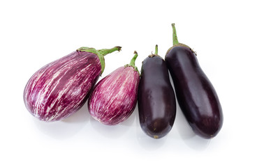 Uncooked purple conventional and Graffiti eggplants on a white background