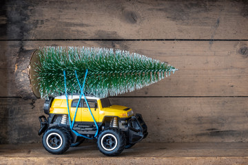 christmas tree on a yellow toy car
