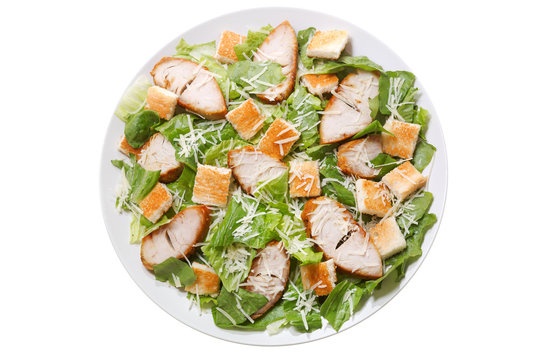 plate of chicken caesar salad isolated on white background