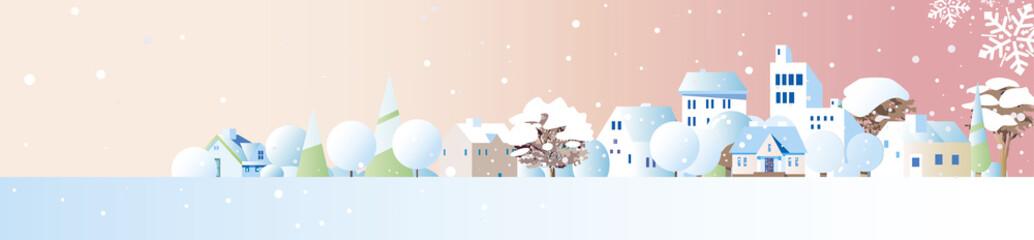 雪の降る街に