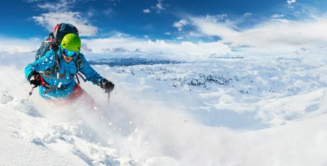 Alpine freeride skier with snow powder explosion
