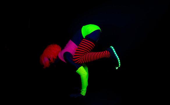 yoag insturtor in flurosecent costume