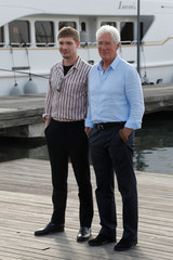 "Richard Gere and Billy Howle pose during a photocall for the television series ""MotherFatherSon"" during the annual MIPCOM television programme market in Cannes"