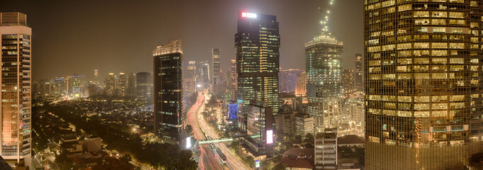 View of Jakarta downtown with skyscrapers lit Wall mural