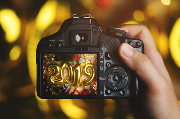 Taking Picture With Camera. 2019 Golden Balloon Between Christmas Decoration