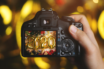 Taking Picture With Camera. 2020 Golden Balloon Between Christmas Decoration