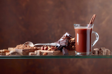 Cocoa with cinnamon, chocolate pieces and various spices.