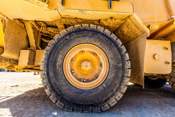 Large wheel of industrial heavy machinery - closeup