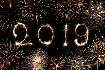 2019 written with sparkles and fireworks