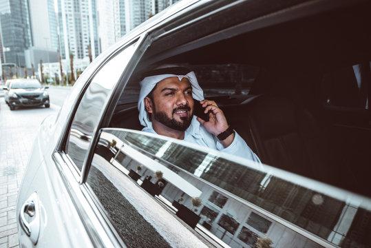 Arabic businessman looking at the skyline in Dubai