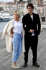 """Maxim Matveev and Viktoria Maslova pose during a photocall for the television series """"Trigger"""" during the annual MIPCOM television programme market in Cannes"""